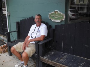 Me sitting on a Bench in front of the old Grocery Store - now an empty restaurant